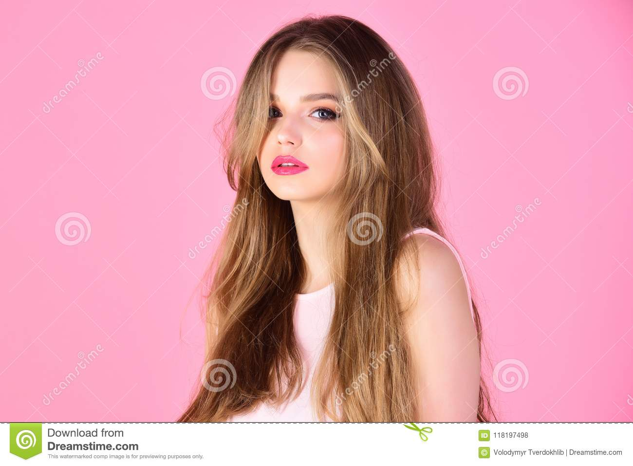 Fashion look concept. Beauty and hairdresser salon. girl with makeup and healthy hair. woman with long hair on pink