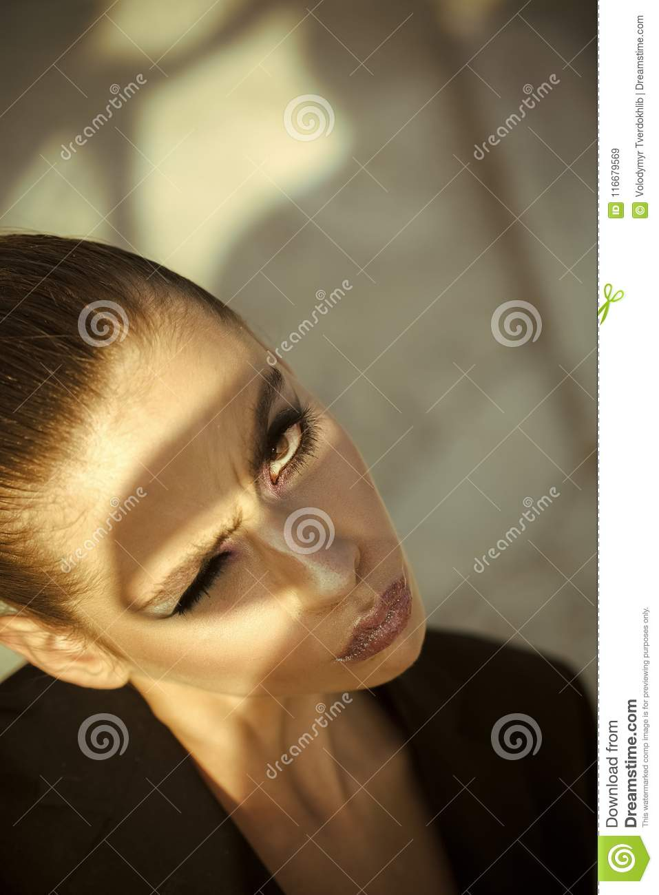 Fashion look of stylish girl, makeup trend. Cosmetics for visage and skincare, hairdresser. Woman with hairstyle, look