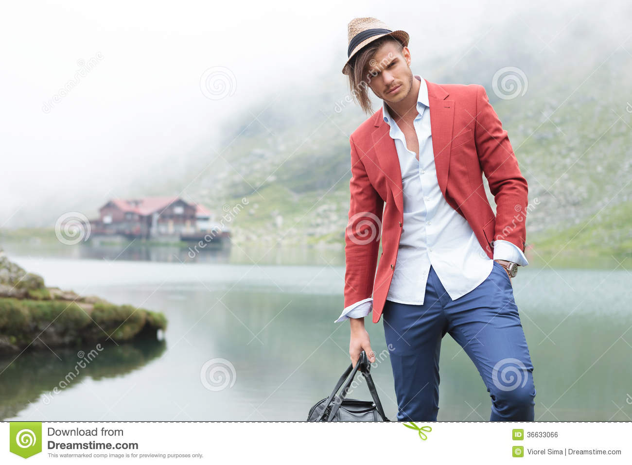 Fashion Male Model Posing In Front Of A Lake Stock Photo