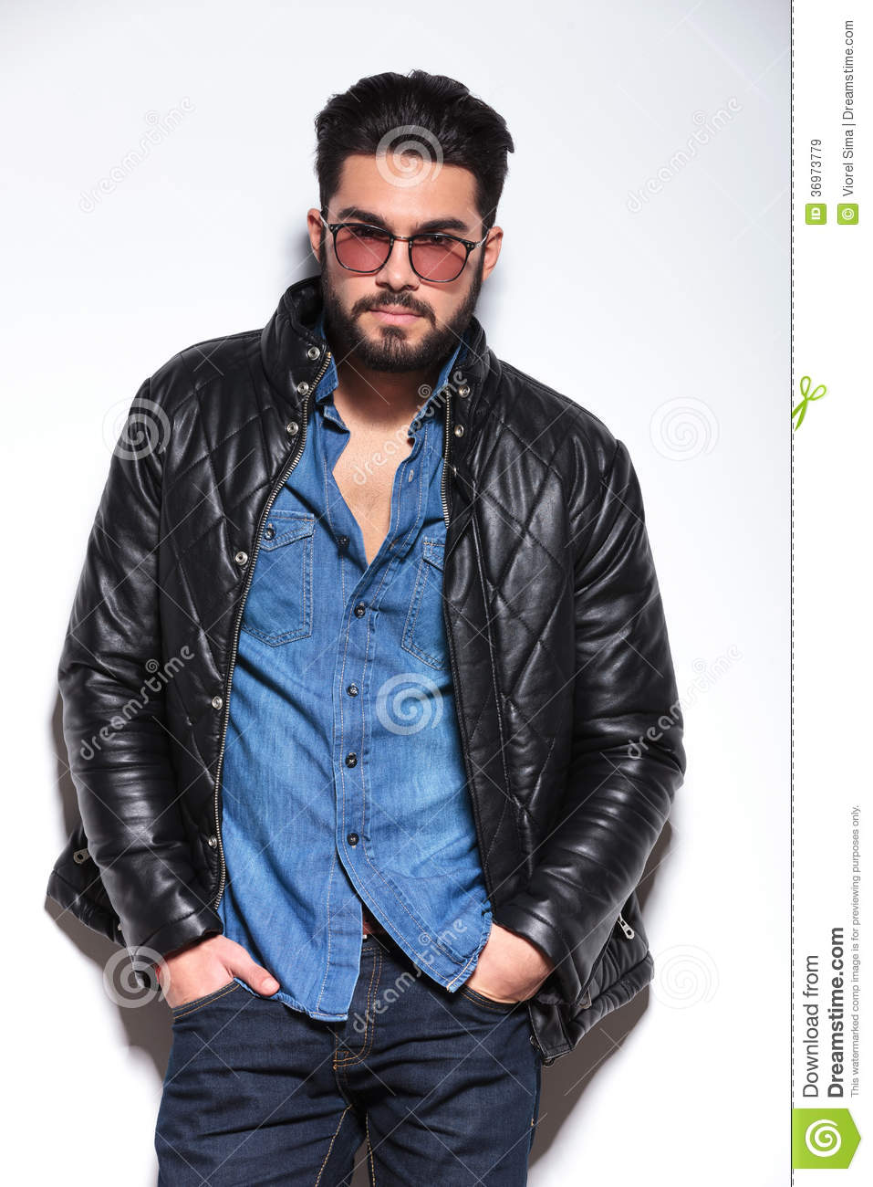 Fashion Man With Glasses And Leather Jacket Posing Royalty