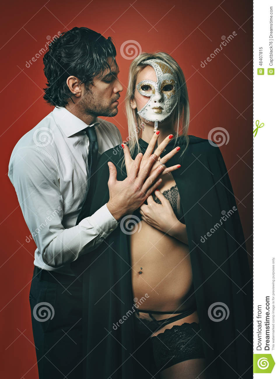5f2bbbdec3fb4 Fashion Man With Masked Woman Stock Image - Image of passion ...