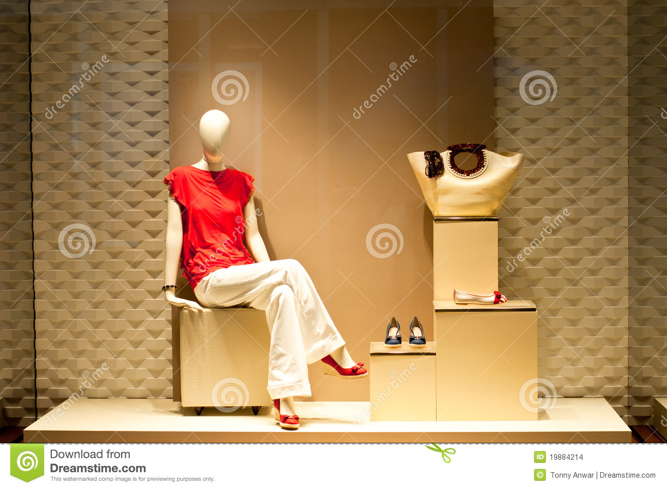 display of fashion mannequin in clothing and accessories shop window