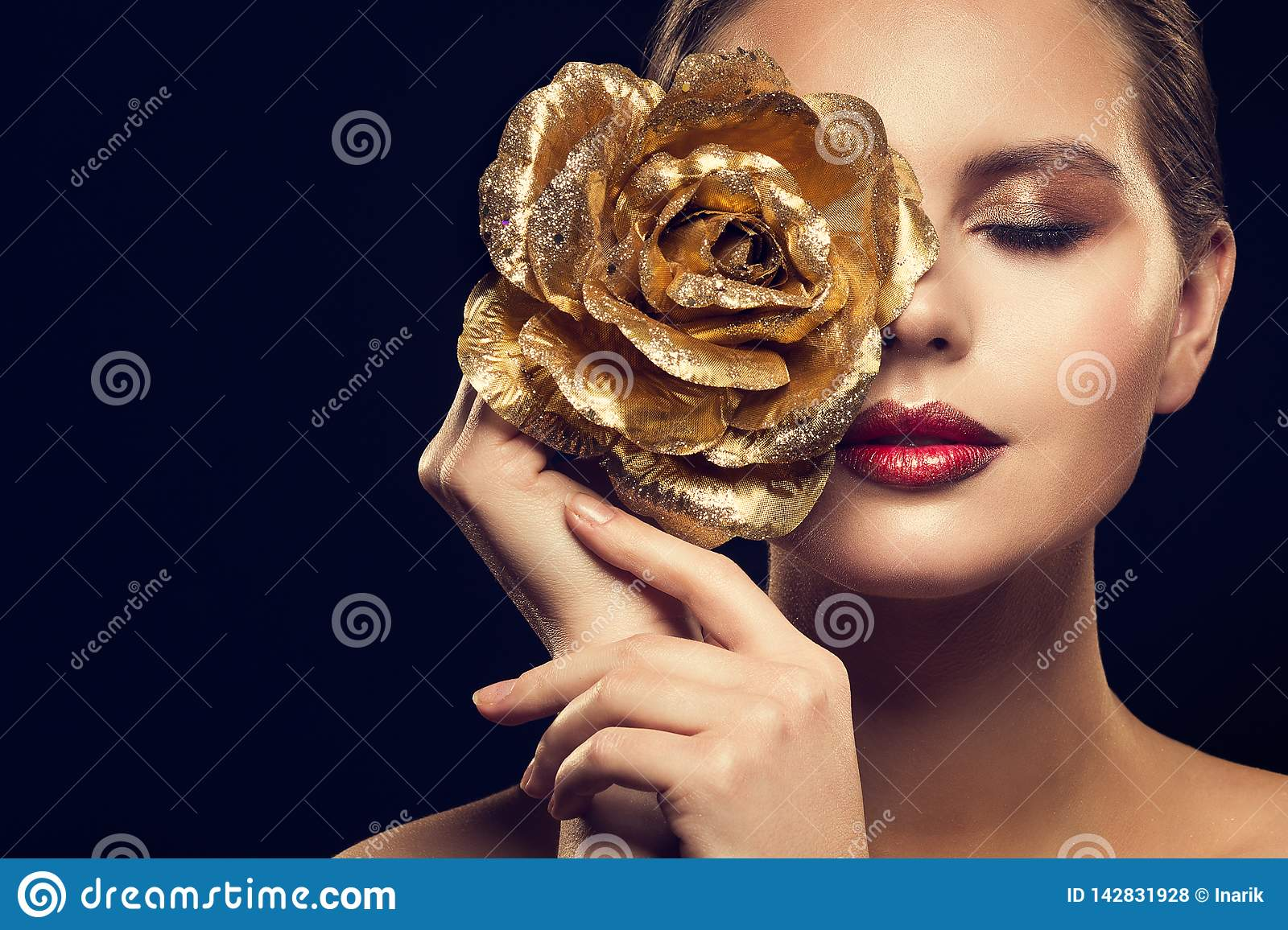 Fashion Model Beauty Portrait with Gold Rose Flower, Golden Woman Luxury Makeup an Rose Jewelry