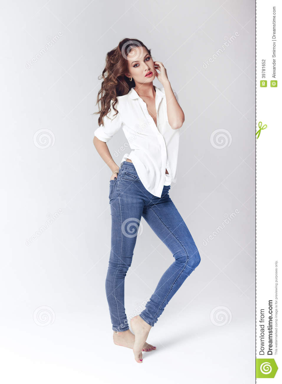Fashion Model In A Blouse And Jeans Barefoot Stock