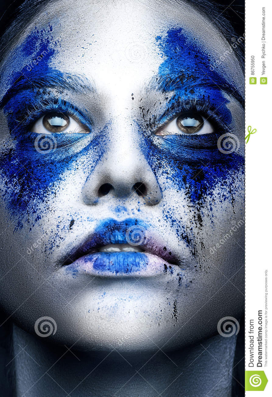 Fashion model girl portrait with colorful powder make up. Beauty
