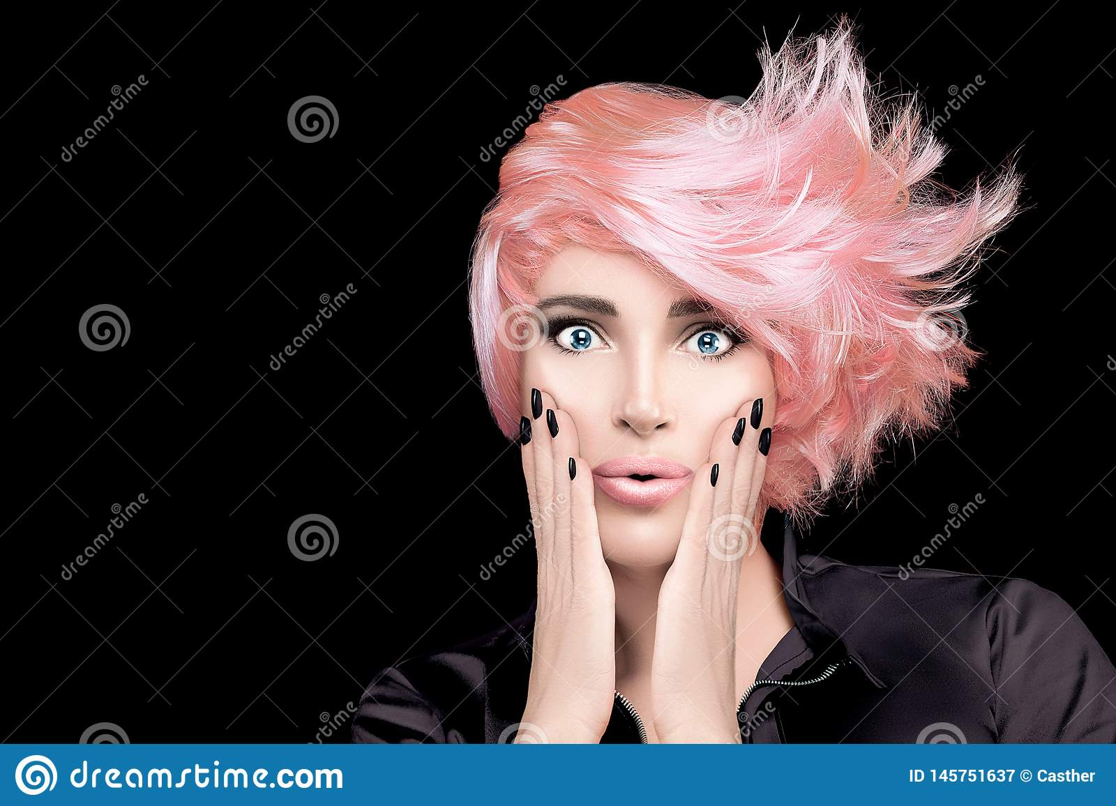 Fashion model girl with stylish rose gold hair. Beauty salon hair coloring concept. Short hairstyle