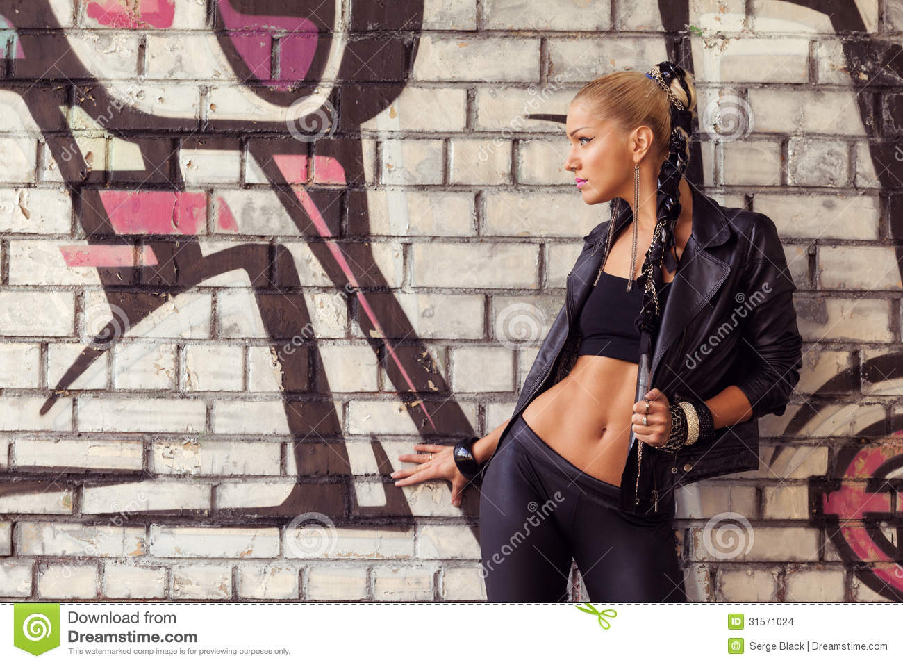 Fashion Model In Glam Rock Style On Street Stock Photo