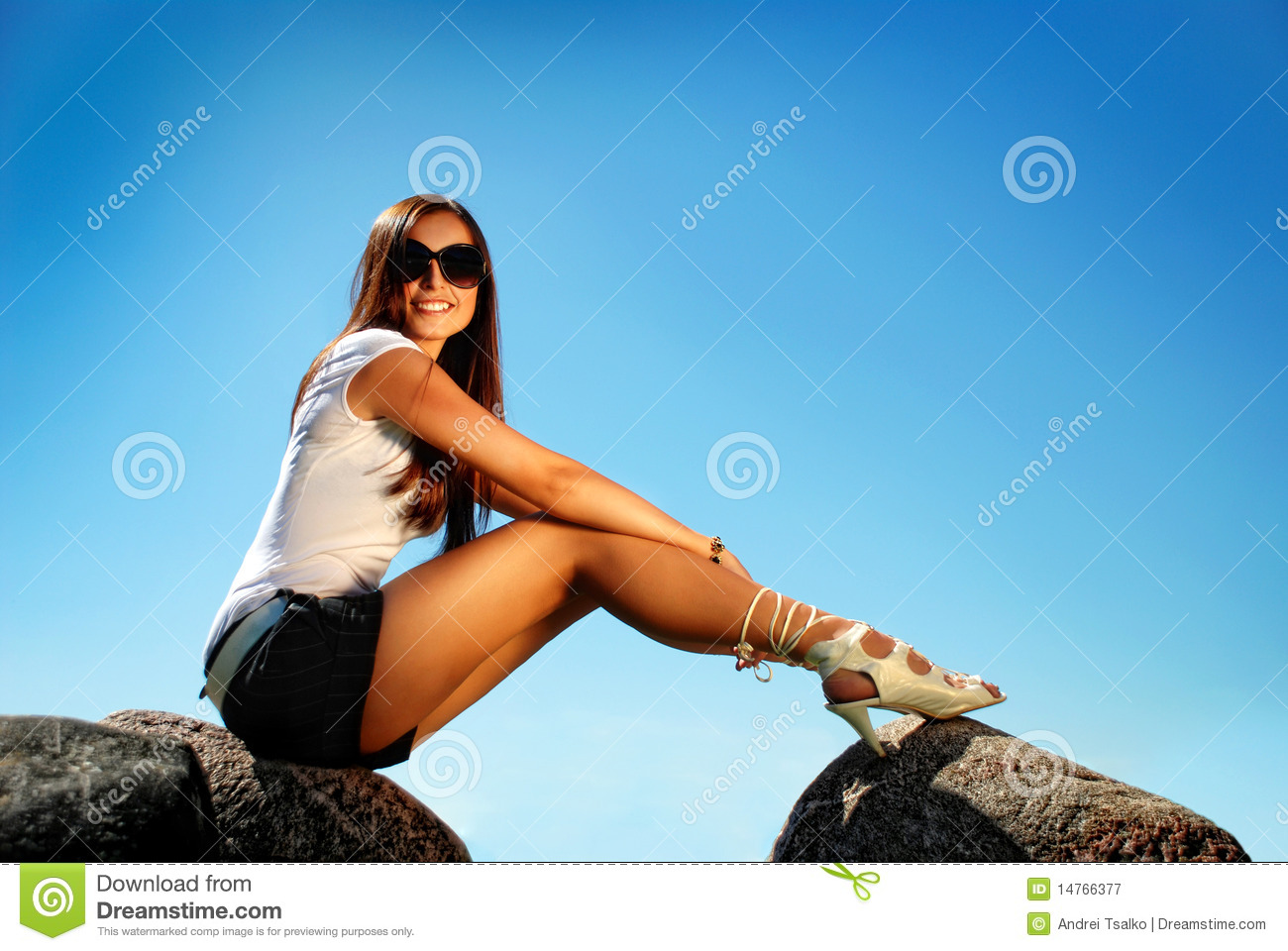Fashion Model In High Hill Shoes An A Stone. Royalty Free Stock