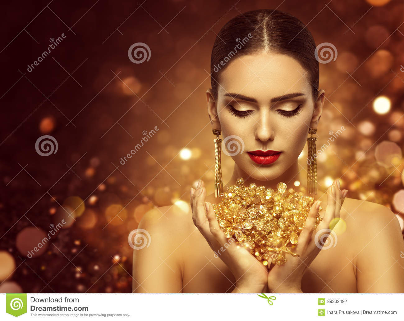 Fashion Model Holding Gold Jewelry in Hands, Woman Golden Beauty