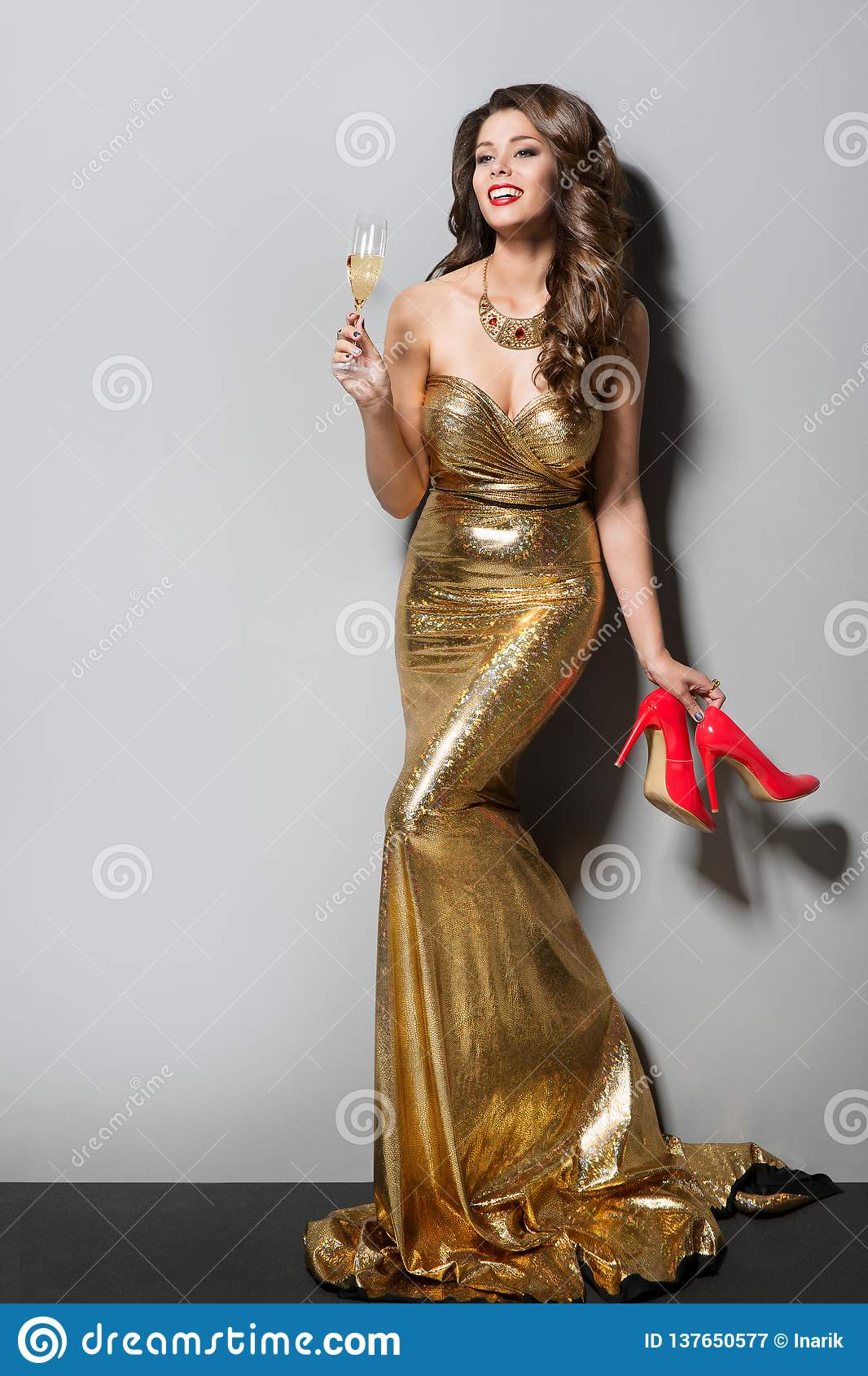 Fashion Model in Long Gold Dress Dancing and Drinking, Happy Elegant Woman, High Heel Shoes
