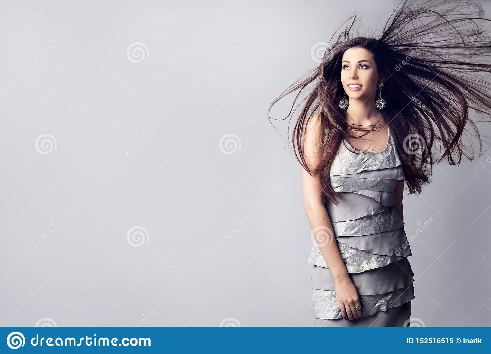 Fashion Model Long Hair Fluttering on Wind, Beautiful Woman Hairstyle Studio Portrait on White