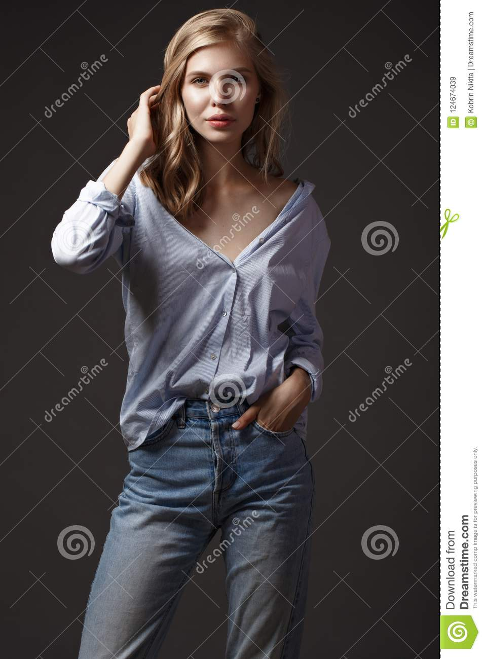 Fashion model with long hair, perfect skin is posing in studio for glamour test photo shoot showing different poses