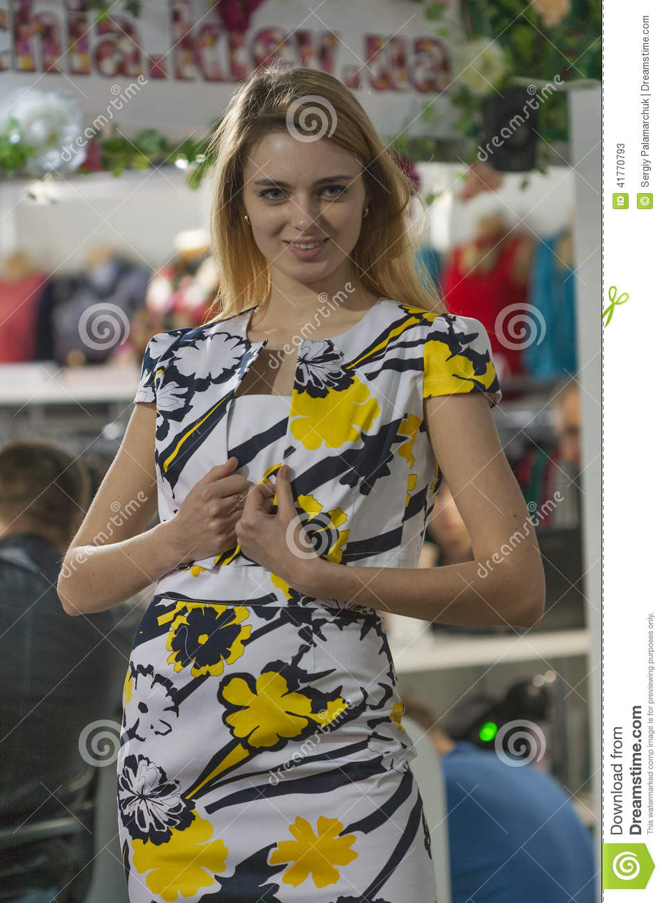 Fashion model in mixed yellow, white and black dre