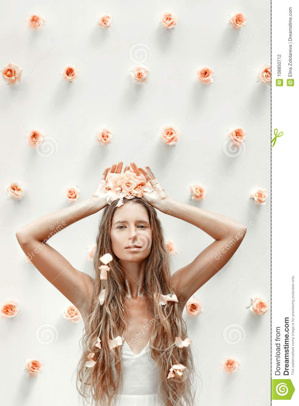Fashion model portrait with roses and golden dust