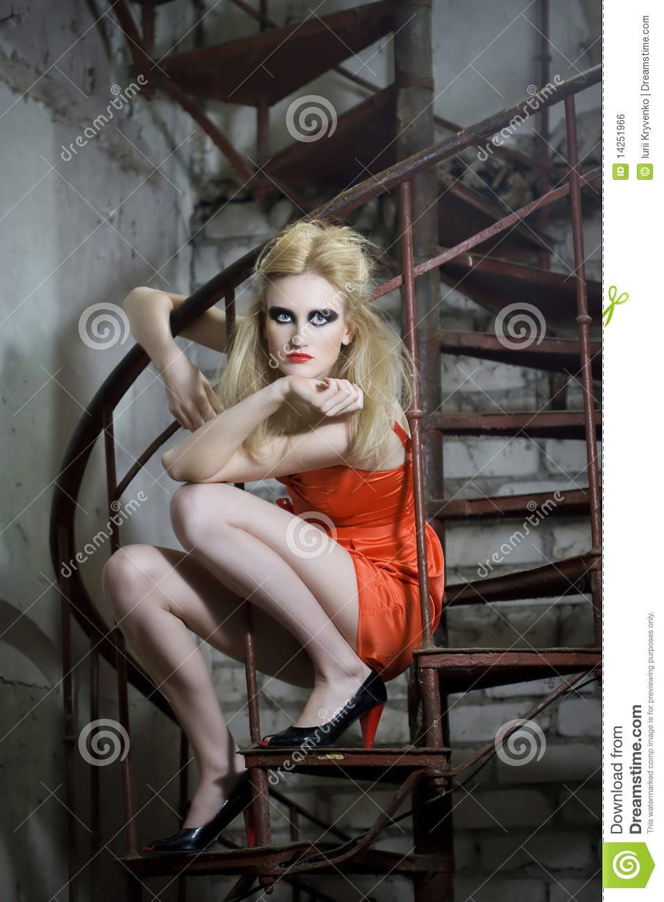 Fashion Model On The Spiral Stairs Royalty Free Stock