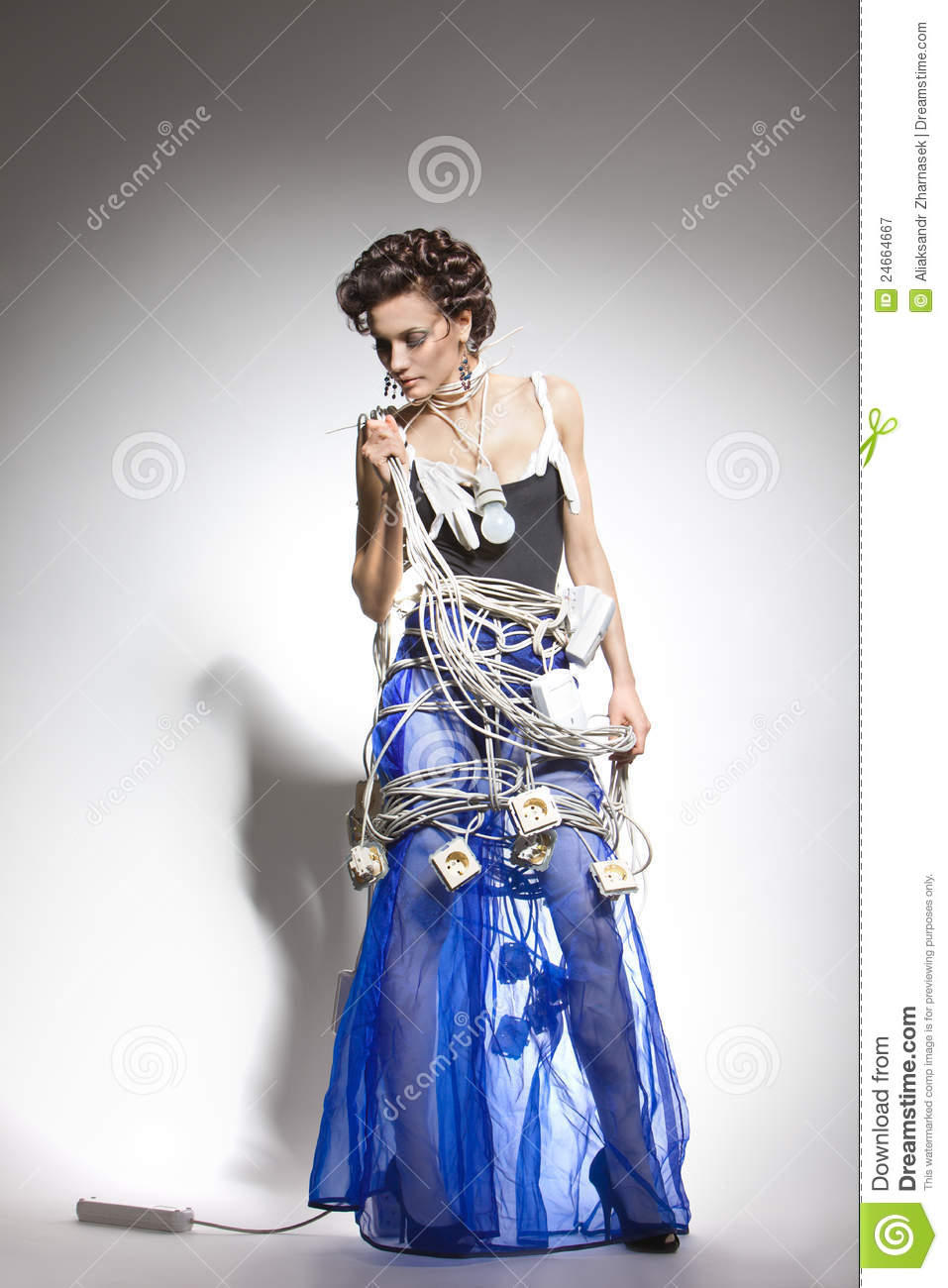 Fashion Model in an unusual costume of the wires