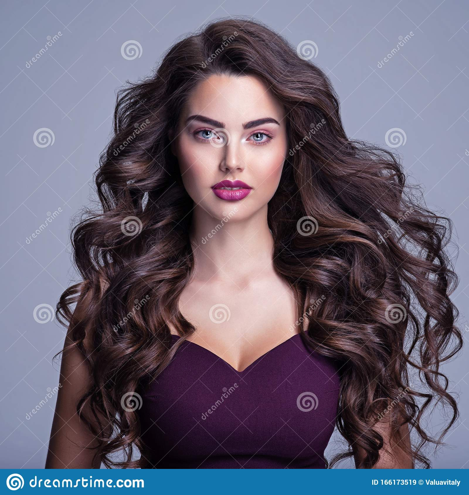 Face Of A Beautiful Woman With Long Brown Curly Hair Fashion Model With Wavy Hairstyle Attractive Young Girl With Curly Hair Stock Image Image Of Black Hair 166173519