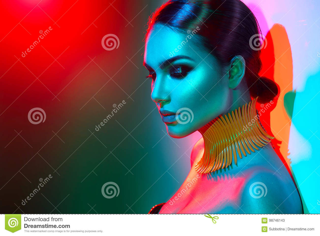 Fashion model woman in colorful bright lights posing