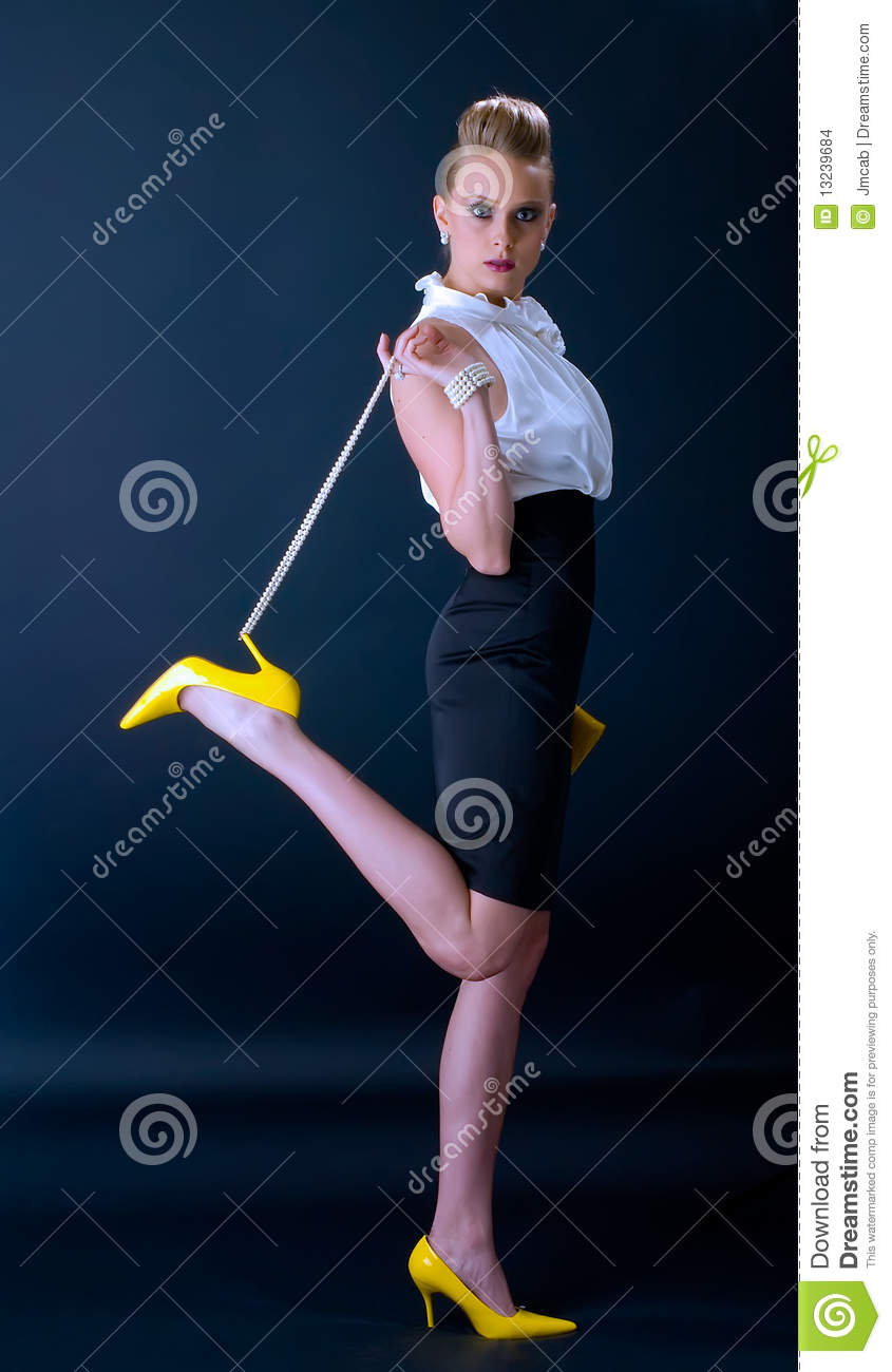 Fashion model in yellow shoes