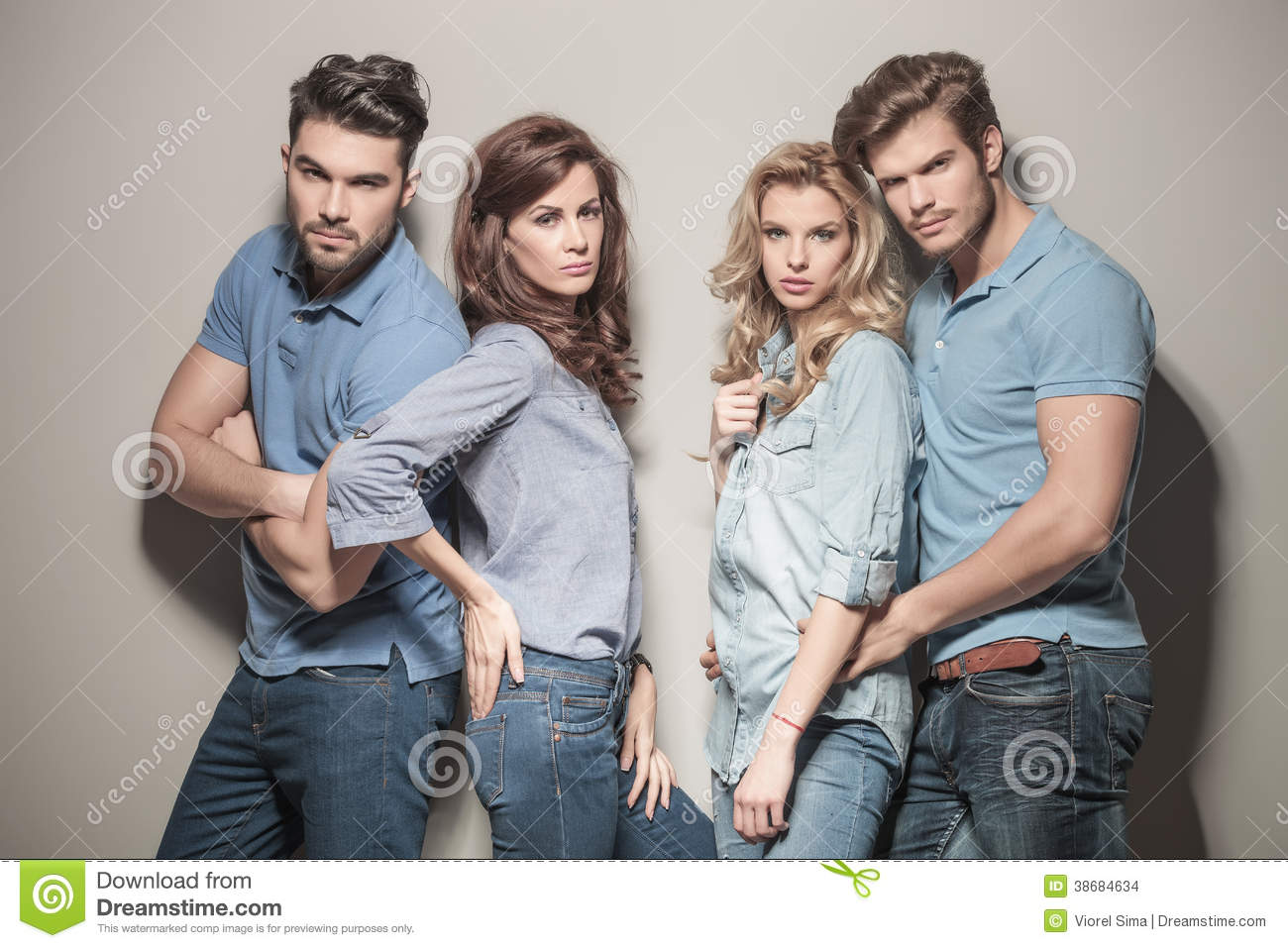 Fashion Models In Blue Jeans And Polo Shirts Stock Photo ...