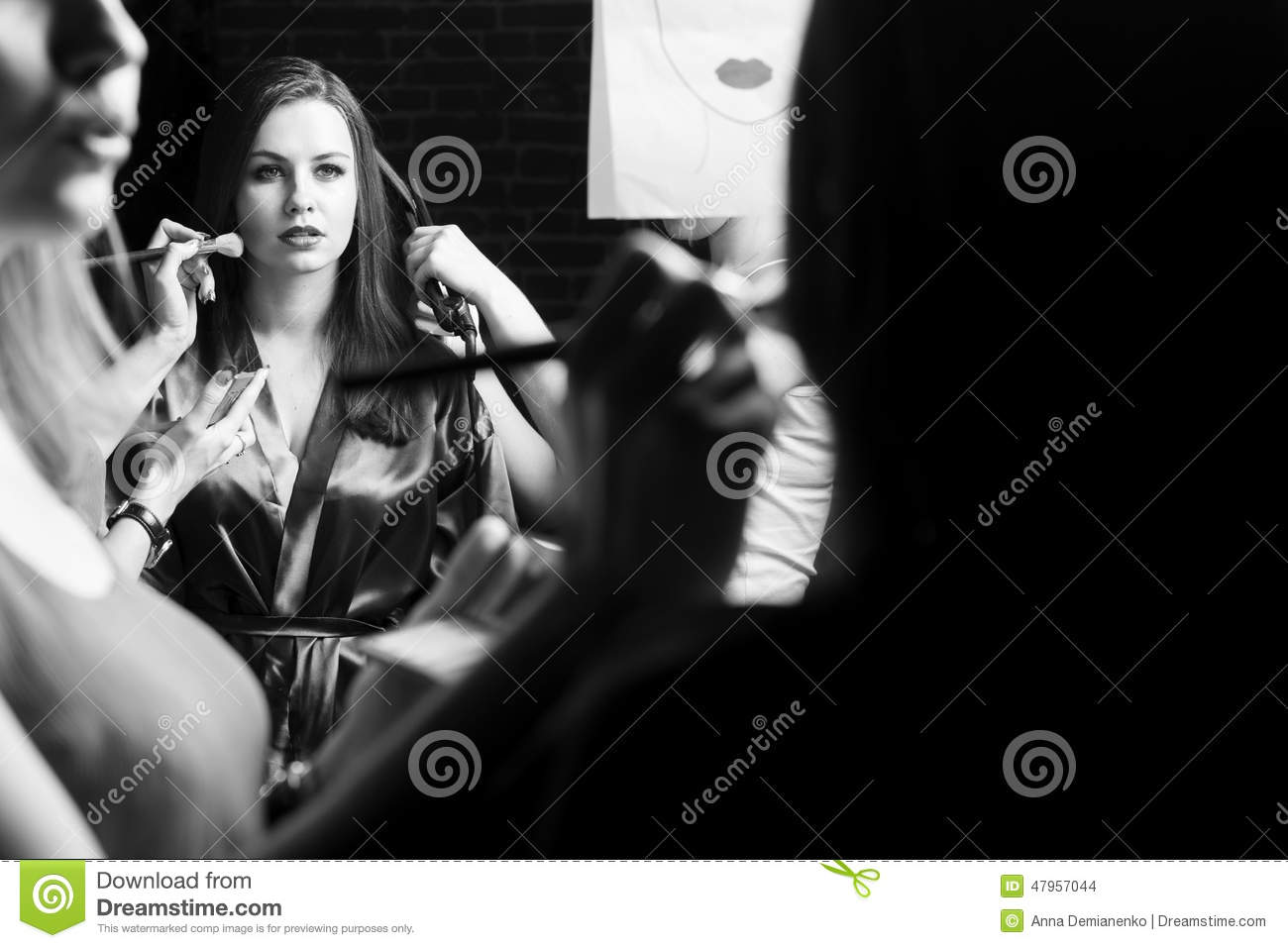 Fashion models prepared for runway by stylish designer. Black and white photography