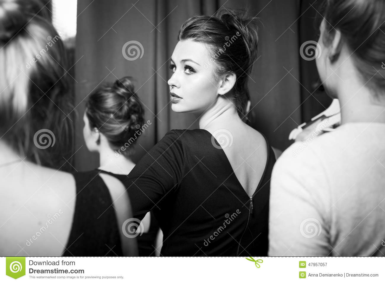 Fashion models prepared for runway by stylish designer black and white photography plus size