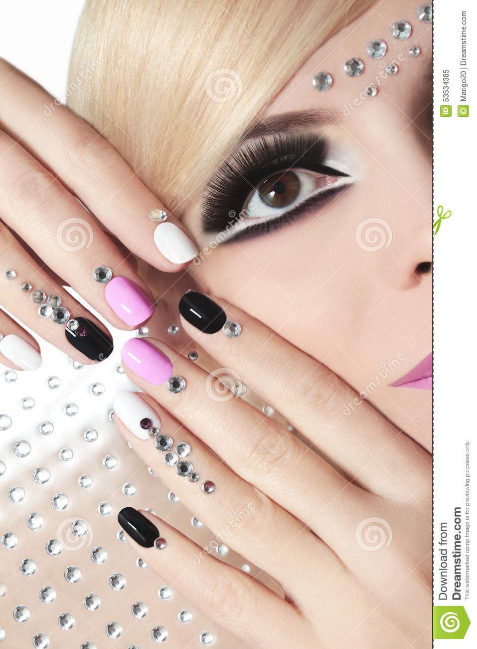 Fashion Nail Trend: Fashion Nails And Makeup With Rhinestones. Stock Image