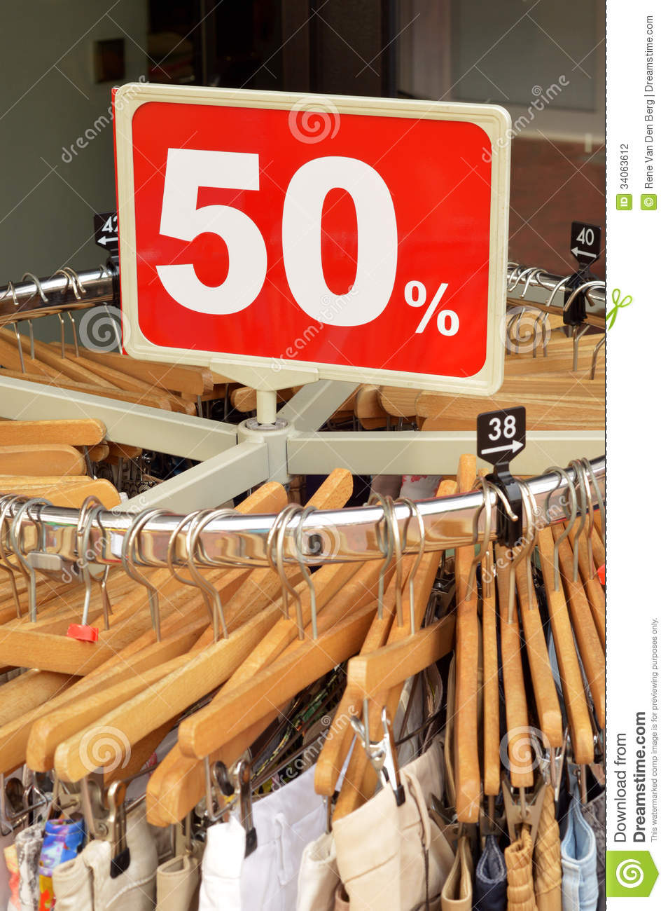Sale in a clothing store - 50% discount sign at a clothes rack