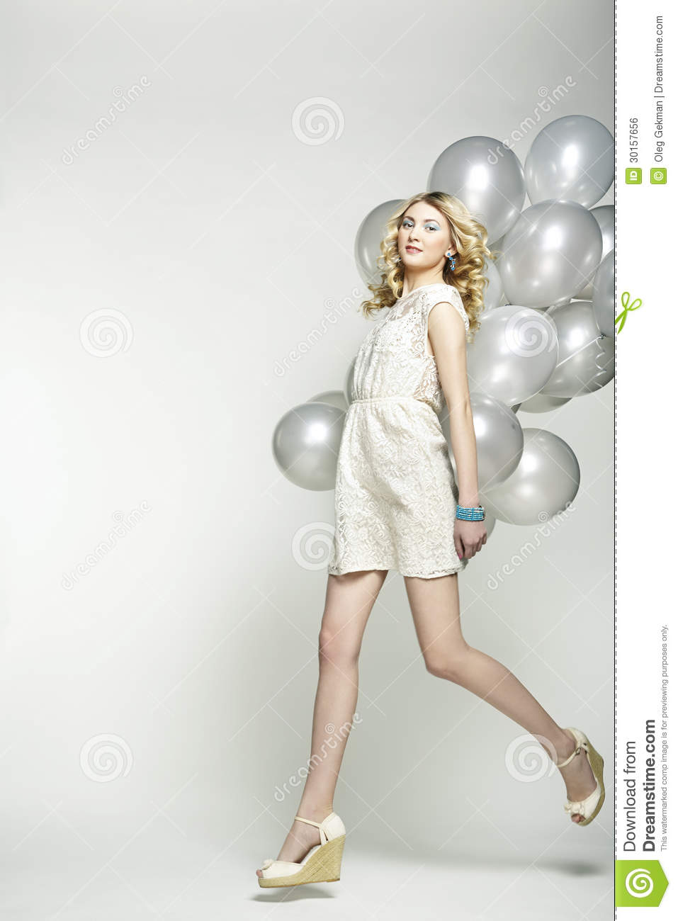 Fashion photo of beautiful woman with balloon girl posing for A beautiful you at vesuvio salon studios