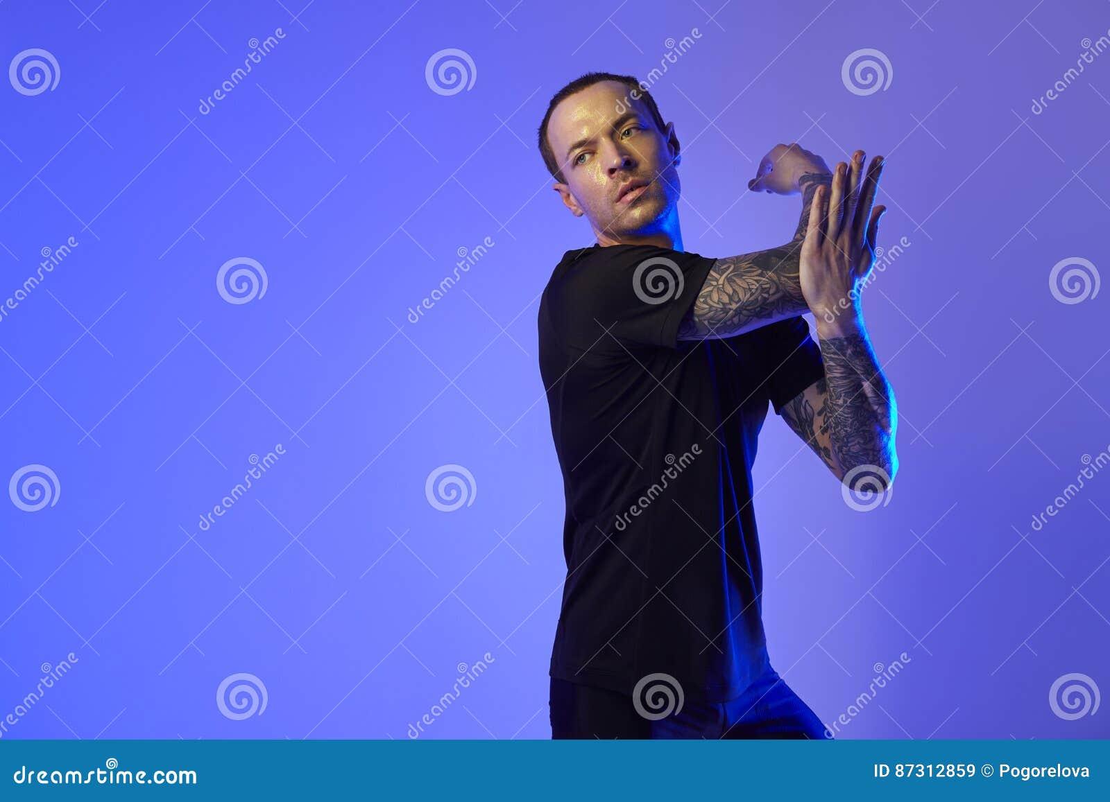 portrait of sport fit attractive man in sportswear jacket color