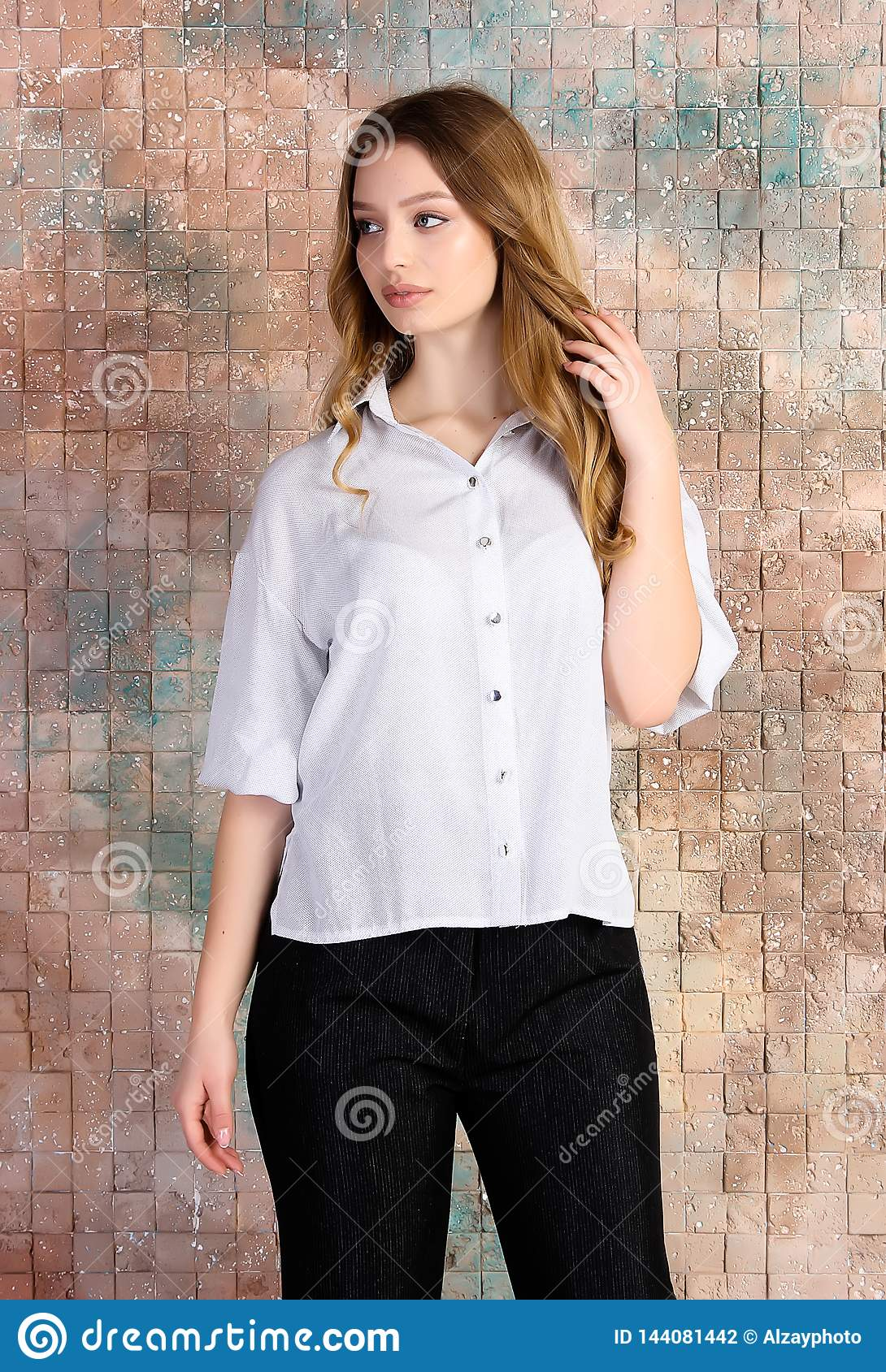 Fashion photo of young beautiful female model in dress.