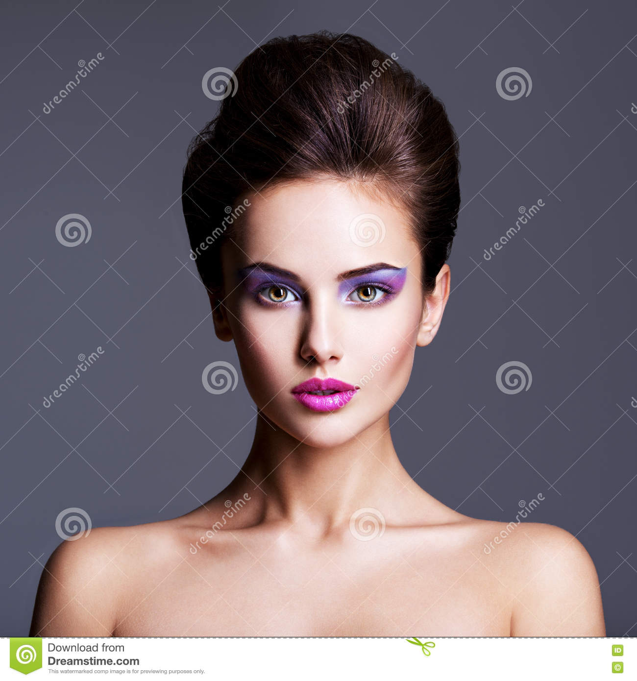 Fashion portrait of a beautiful girl with creative hairstyle an