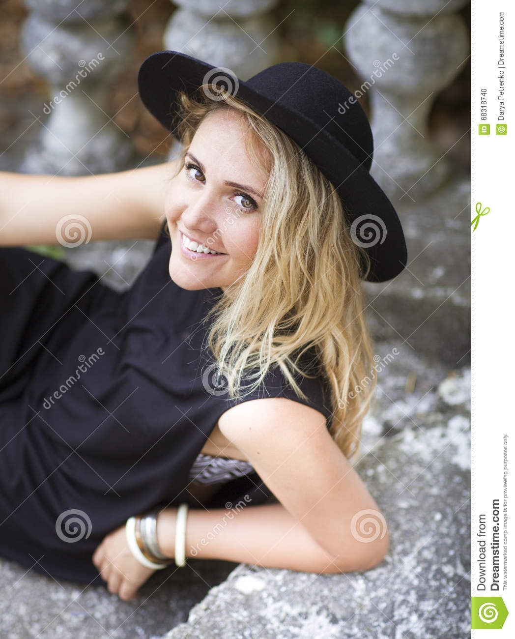 37716cac483 Fashion portrait of beautiful hippie young woman wearing boho chic clothes  and black hat outdoors