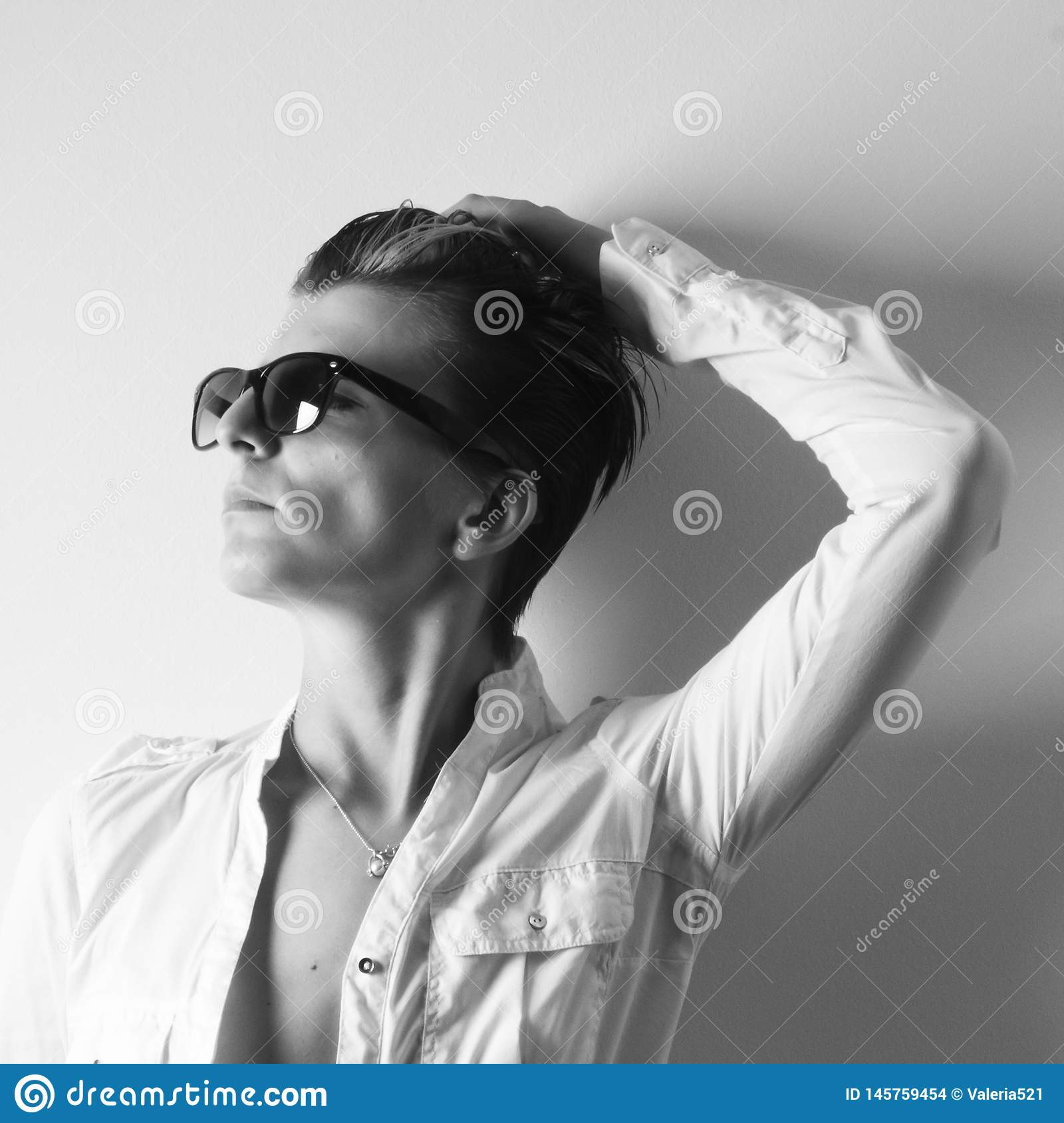 Fashion portrait of a girl wearing modern sunglasses in black and white
