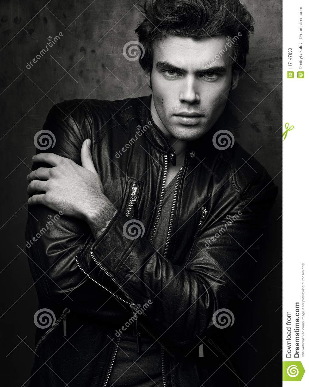 Fashion Portrait Of Handsome Young Man In A Black Leather Jacket