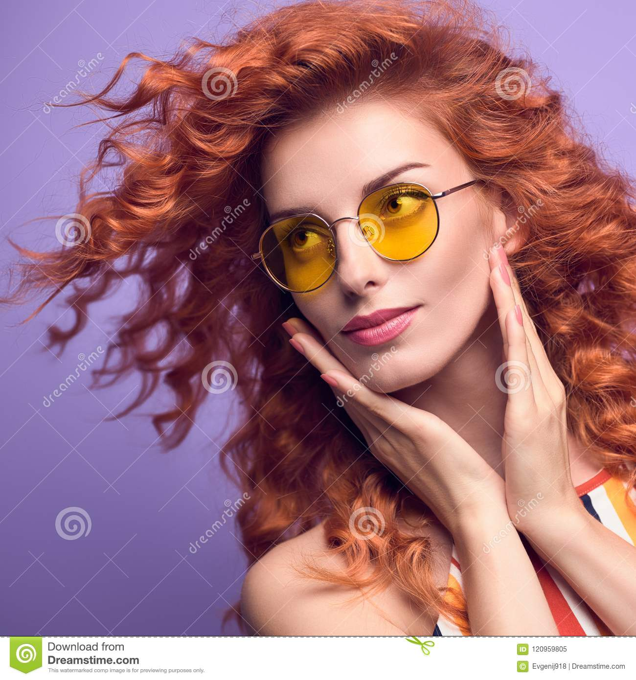 5fc307cd92e0 Fashion Portrait Young Beautiful Happy woman with Shiny Curly Hairstyle  Smiling in Studio. Redhead Girl in Stylish Summer Sunglasses. Attractive  Playful ...