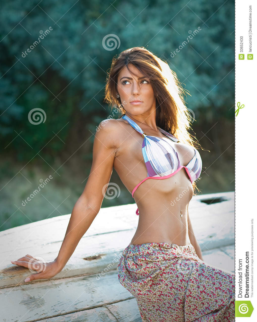 Fashion Portrait Of Brunette Girl In Swimsuit Leaning On A Wooden Boat Stock Photo - Image: 33652430