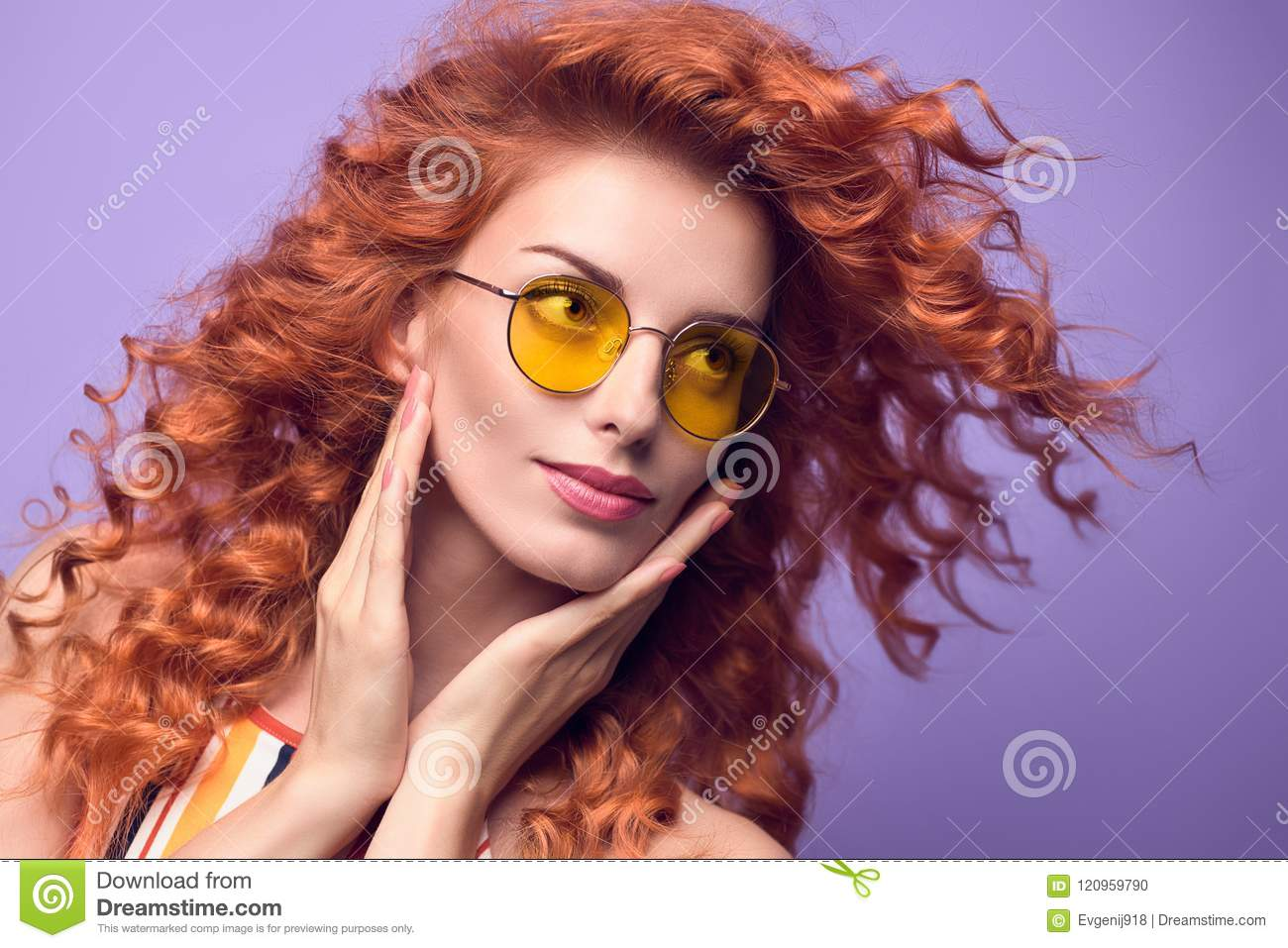 ecbc484d1ceb Fashion Portrait Young Beautiful Happy woman with Trendy Curly Hairstyle  Smiling in Studio. Redhead Girl in Stylish Summer Sunglasses. Attractive  Playful ...