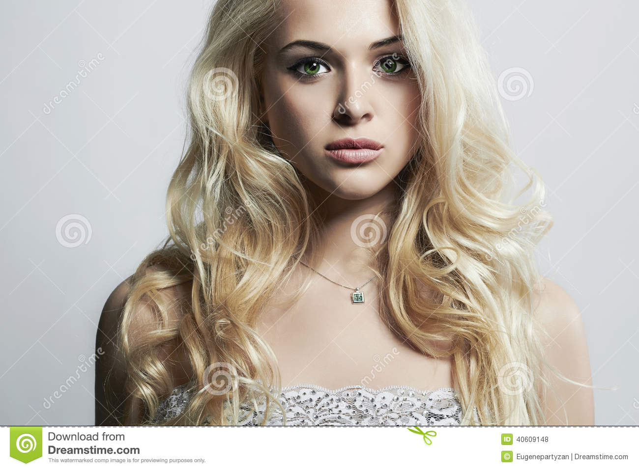 Fashion portrait of young beautiful woman.Sexy blonde.Curly hairstyle