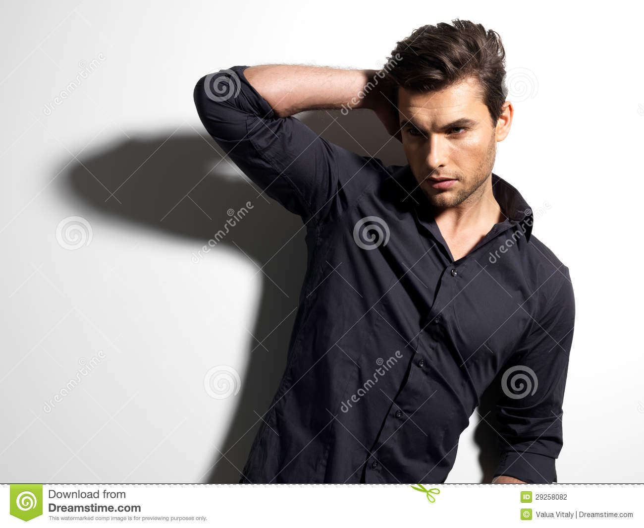 Fashion Portrait Of Young Man In Black Shirt Royalty Free Stock ...