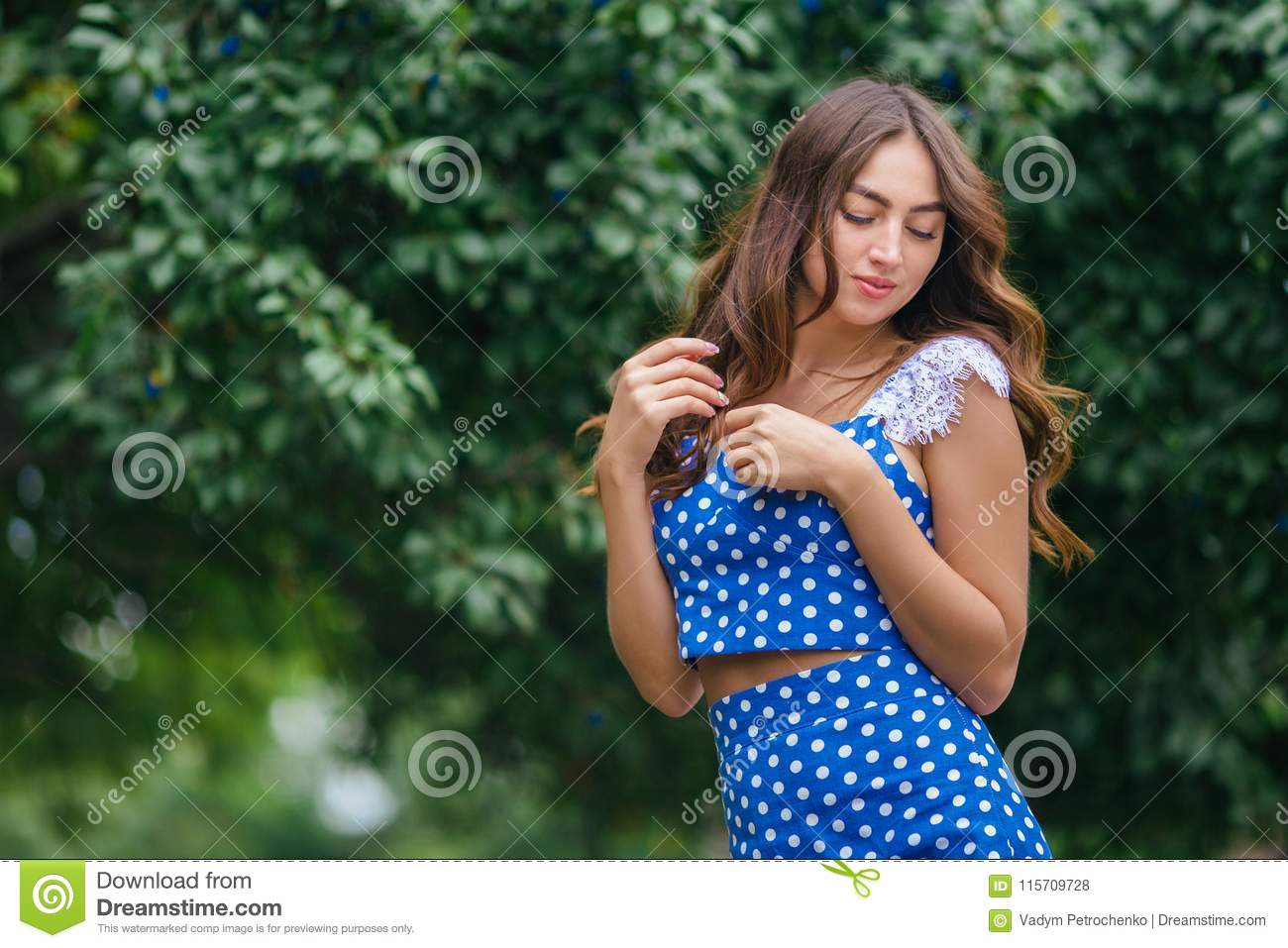 Fashion portrait of young pretty trendy girl with beautiful curl
