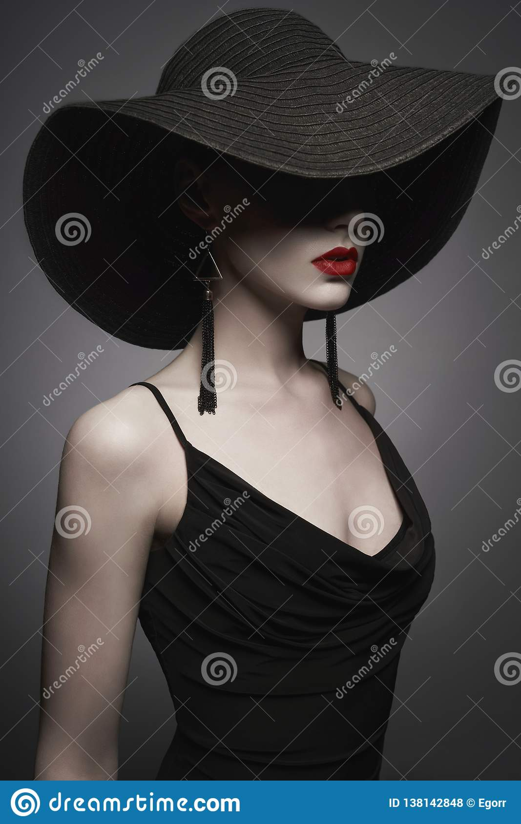Portrait of young lady with black hat and evening dress