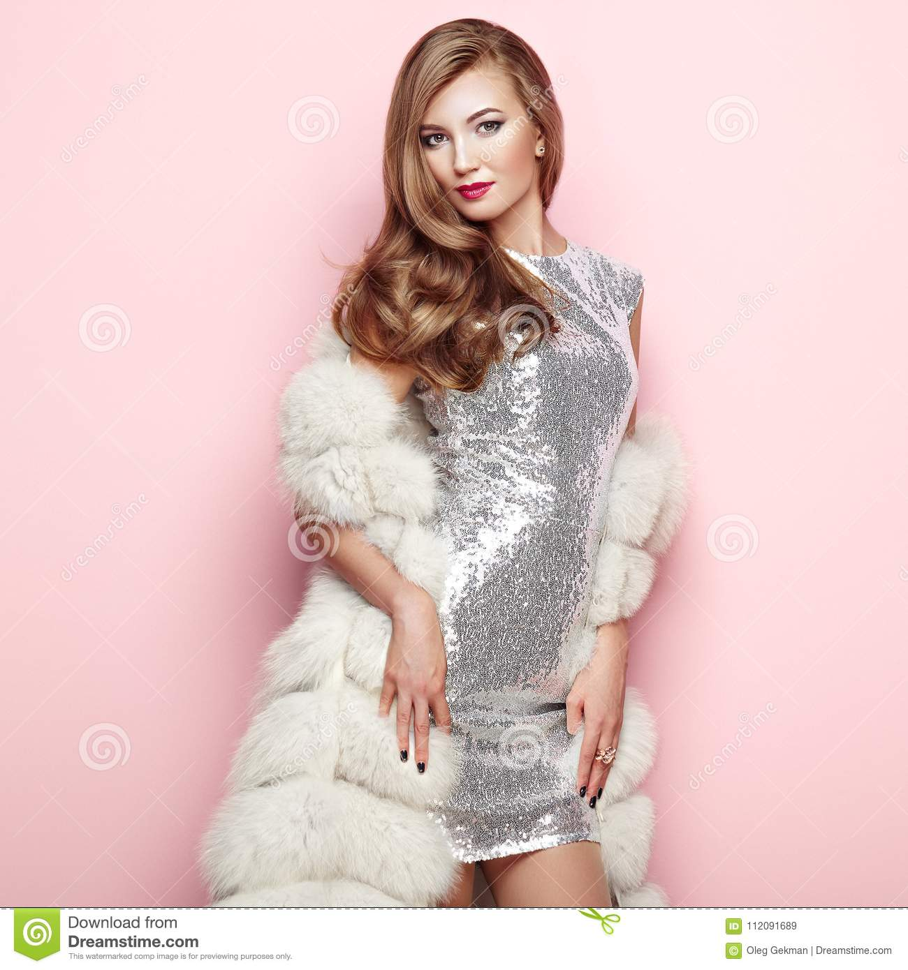 Fashion portrait young woman in white fur coat