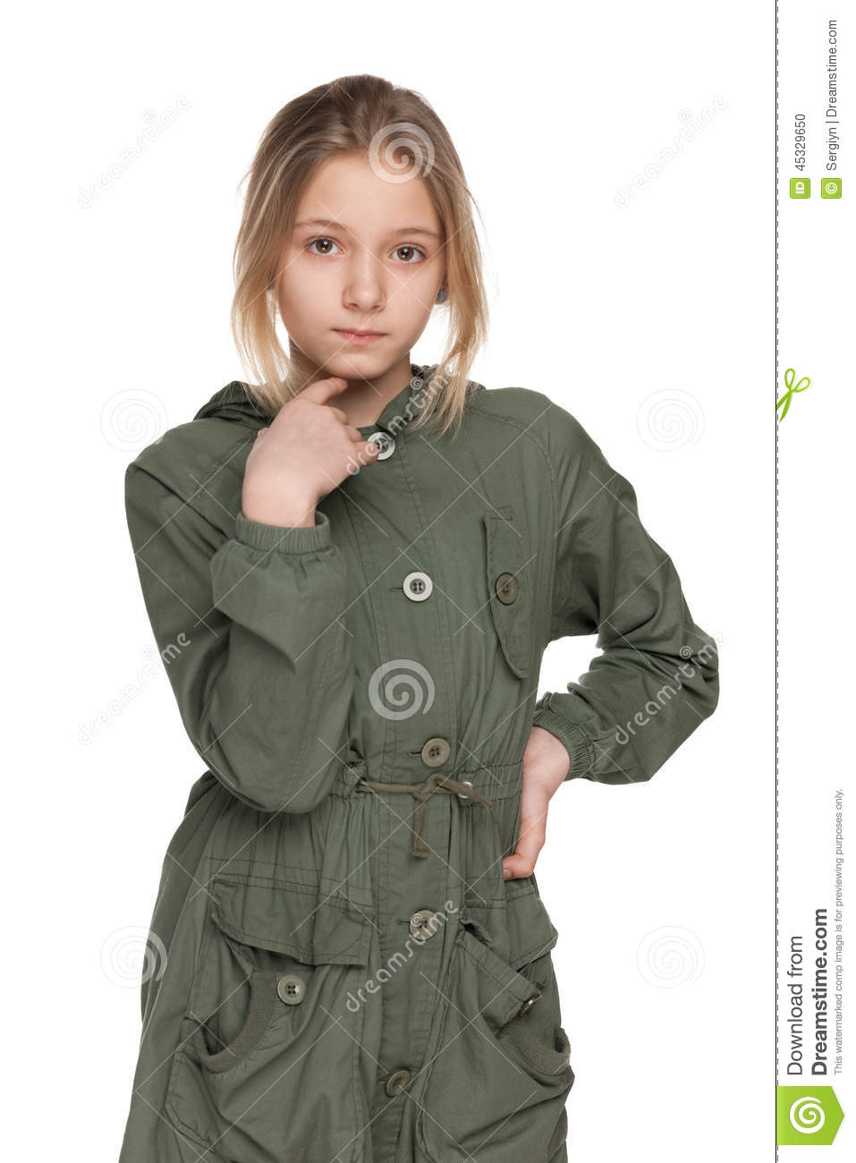 fashion preteen girl in the green coat on the white background.