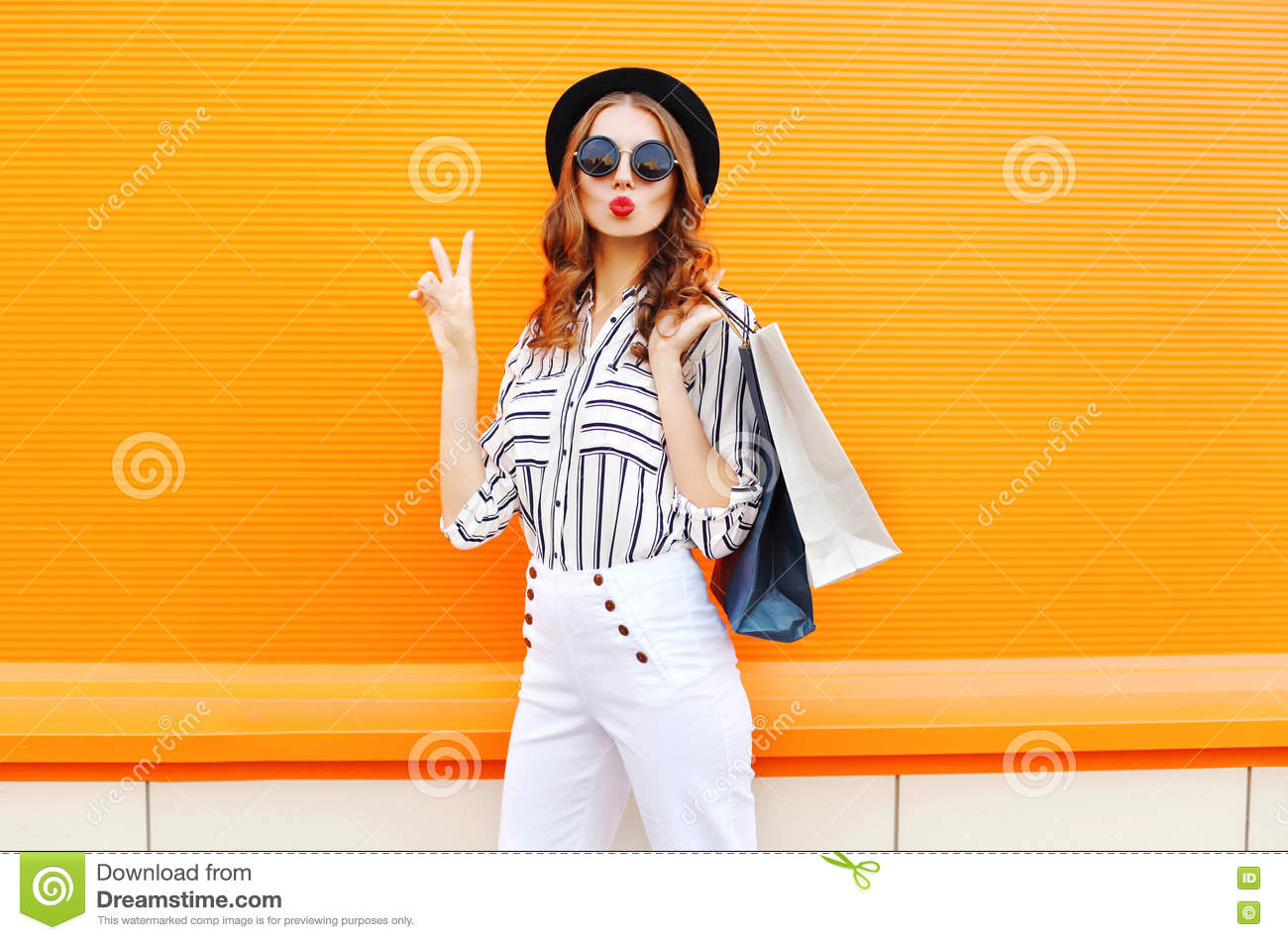 Download Fashion Pretty Cool Young Girl With Shopping Bags Wearing A Black Hat White Pants Over Colorful Orange Stock Image - Image of cool, lifestyle: 79063329