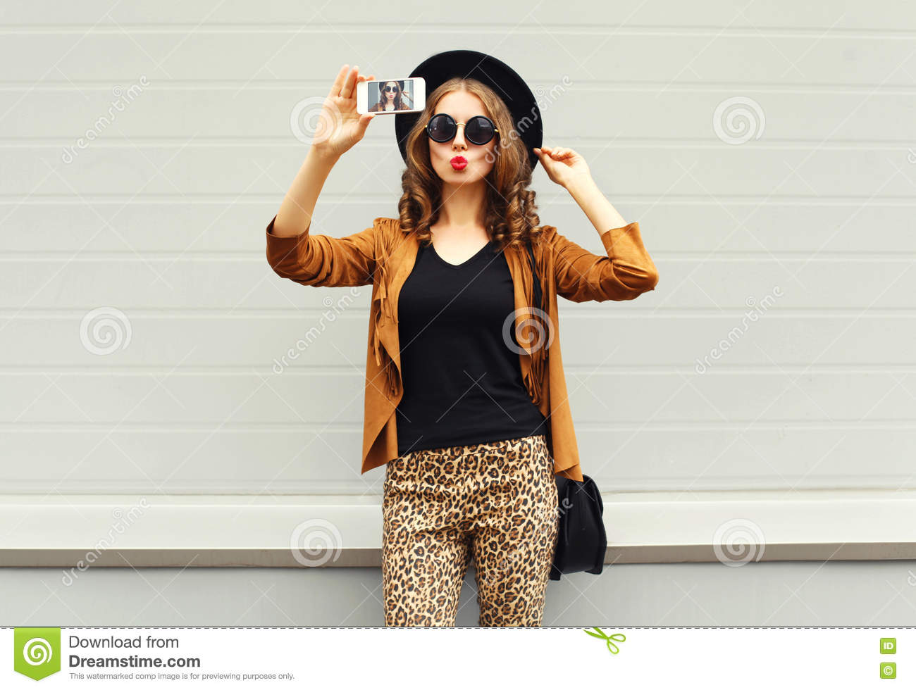 Fashion pretty young woman model taking photo picture self-portrait on smartphone wearing retro elegant hat, sunglasses