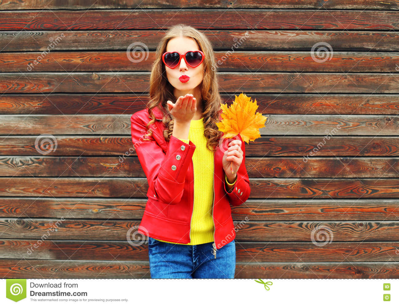 Fashion Pretty Young Woman Sends Air Sweet Kiss With Yellow Maple Leafs In Autumn Day Over Wooden Background Wearing Red Leather Stock Photo Image Of Clothes Lady 78645456
