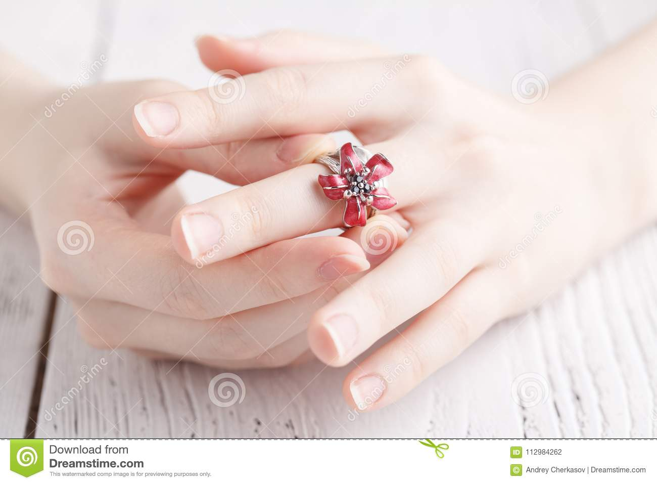 Fashion ring in female hands, close up