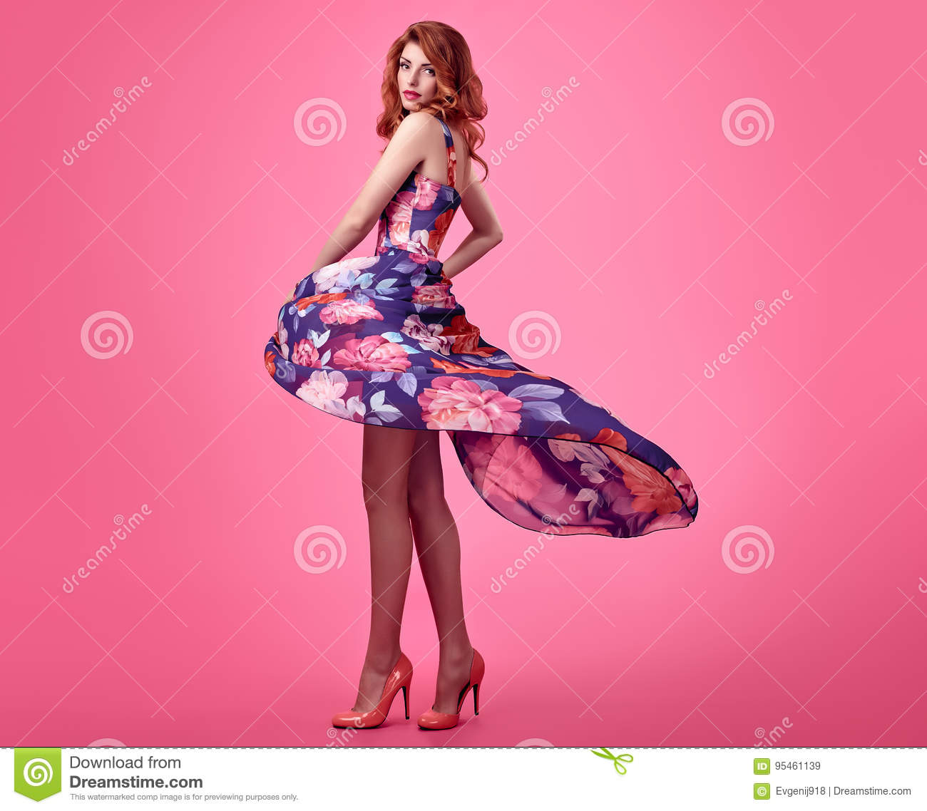 015d00109 Fashion Sensual Redhead Model in fashion pose. Beauty Woman in Summer Outfit.  Trendy Floral Dress