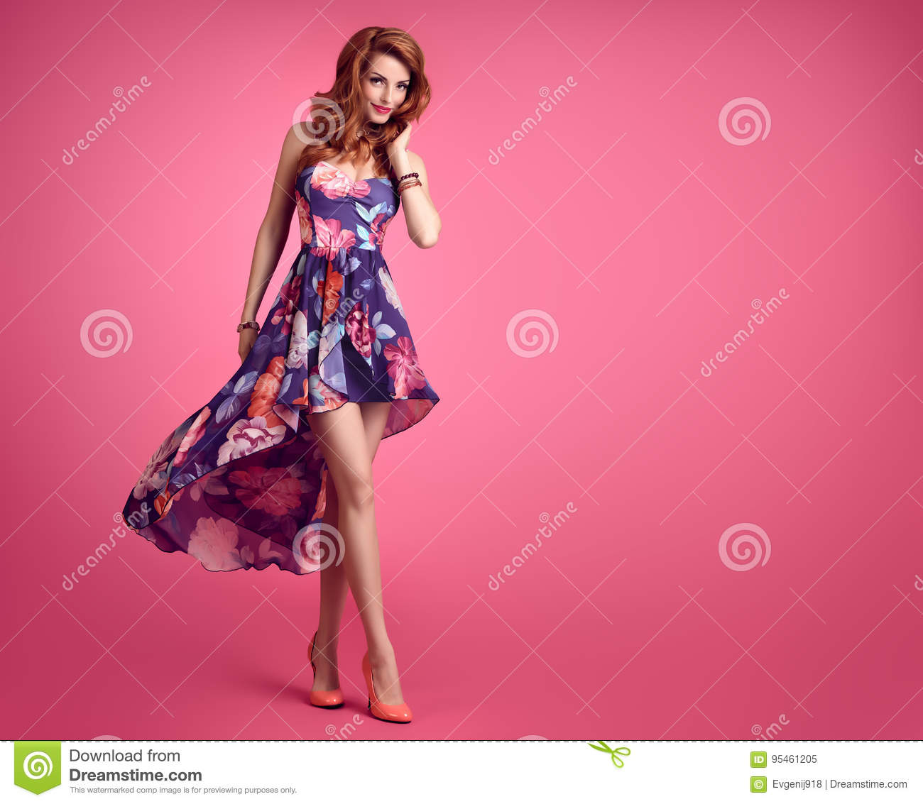 95f24d133d Sensual Redhead woman in Fashion Trendy Floral summer Dress Smiling. Beauty  Model in fashion pose. Stylish Curly Wavy hairstyle